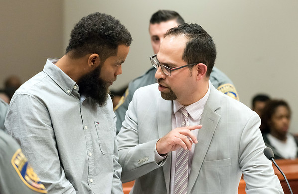 12/03/18 Wesley Bunnell | Staff Vincent Slaughter was arraigned in New Britain Superior Court on Monday afternoon in front of Judge Joan Alexander on several charges including Assault 1 and Criminal Weapon Possession. Slaughter speaks with his Defense Attorney Chester Fernandez, R.