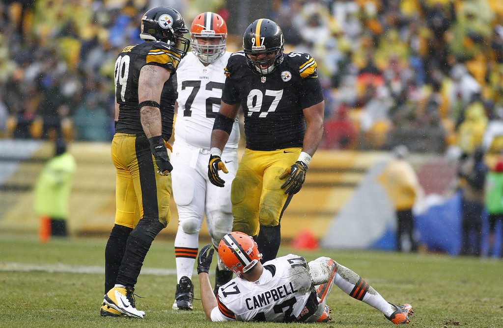 . Cameron Heyward #97 and Brett Keisel #99 of the Pittsburgh Steelers celebrate after causing a fumble against Jason Campbell #17 of the Cleveland Browns during the game on December 29, 2013 at Heinz Field in Pittsburgh, Pennsylvania.  (Photo by Justin K. Aller/Getty Images)