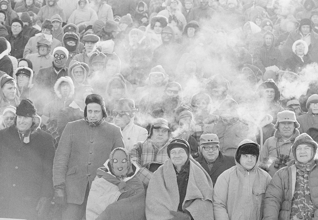 . FILE - In this Dec. 31, 1967, file photo, fans watch the Green Bay Packers play the Dallas Cowboys in the NFL Championship game in Green Bay, Wisc. Simply dubbed the Ice Bowl, those who participated in Cowboys-Packers that day at Lambeau Field still shiver when talking about it. (AP Photo/File)