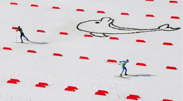 . Russia\'s Ernest Yahin, left, and Italy\'s Samuel Costa compete during the cross-country portion of the Nordic combined Gundersen large hill team competition at the 2014 Winter Olympics, Thursday, Feb. 20, 2014, in Krasnaya Polyana, Russia. (AP Photo/Dmitry Lovetsky)