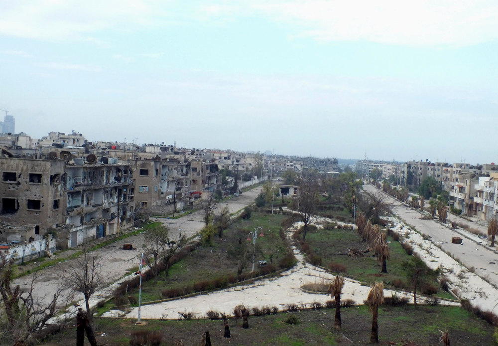 Description of . A general view of the damaged buildings in al-Bayada district in Homs December 13, 2012. Picture taken December 13, 2012. REUTERS/Yazan Homsy