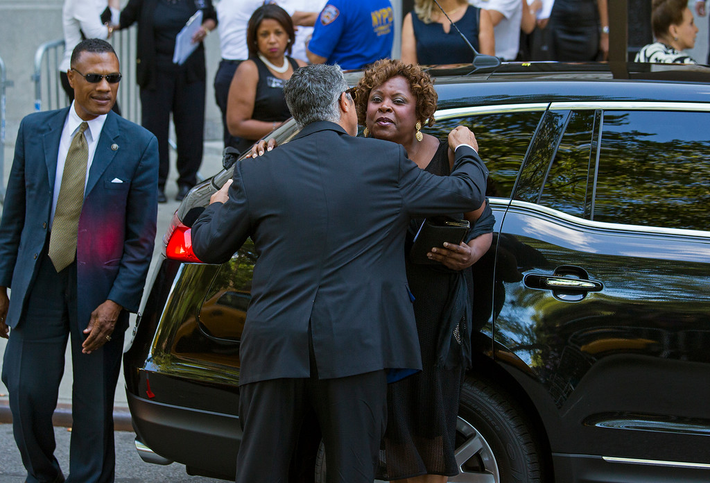 . Radio personality Robin Quivers, right, arrives at a funeral service for comedian Joan Rivers at Temple Emanu-El in New York Sunday, Sept. 7, 2014. Rivers died Thursday, Sept. 4, 2014. She was 81. (AP Photo/Craig Ruttle)