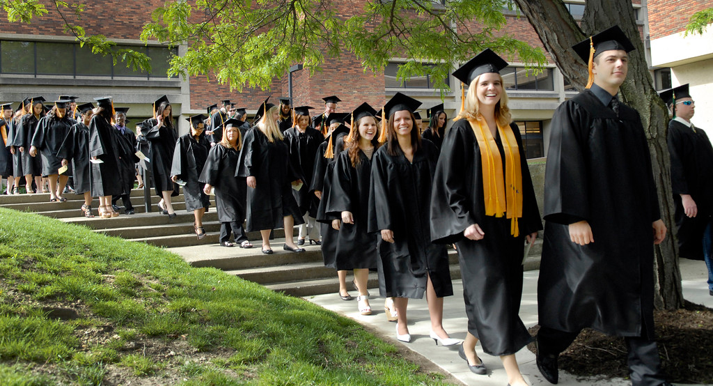 . Graduating students begin their walk to the commencement ceremony at Lakeland Community College in May 2012. (News-Herald file)