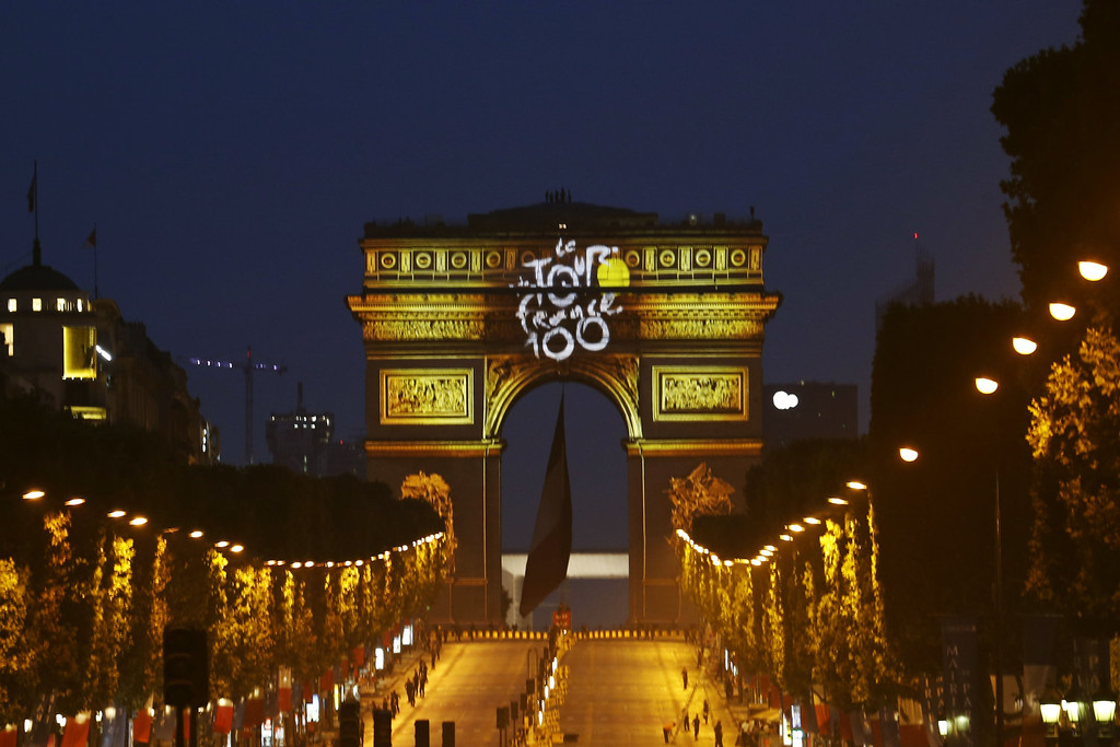 . The color of Tour de France winner yellow jersey is projected on Paris\' landmark Arc de Triomphe on the Champsp Elysees avenue after the end of the twenty first and final stage of the 100th edition of the Tour de France cycling race on July 21, 2013 in Paris.  JOEL SAGET/AFP/Getty Images