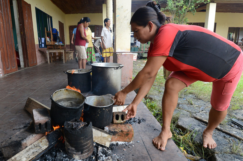 . A woman cooks at a refuge in Rurrenabaque, Bolivia, on February 3, 2014, after Puerto Yumani was flooded due to the overflowing of the Beni river during heavy rains. (Aizar Raldes Nunez/AFP/Getty Images)