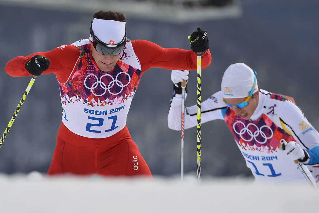 . Switzerland\'s Dario Cologna is chased by Sweden\'s Marcus Hellner (11) as they compete in the Men\'s Cross-Country Skiing 15km + 15km Skiathlon at the Laura Cross-Country Ski and Biathlon Center during the Sochi Winter Olympics on February 9, 2014, in Rosa Khutor. Cologna snatched the gold medal and Hellner silver.  ALBERTO PIZZOLI/AFP/Getty Images