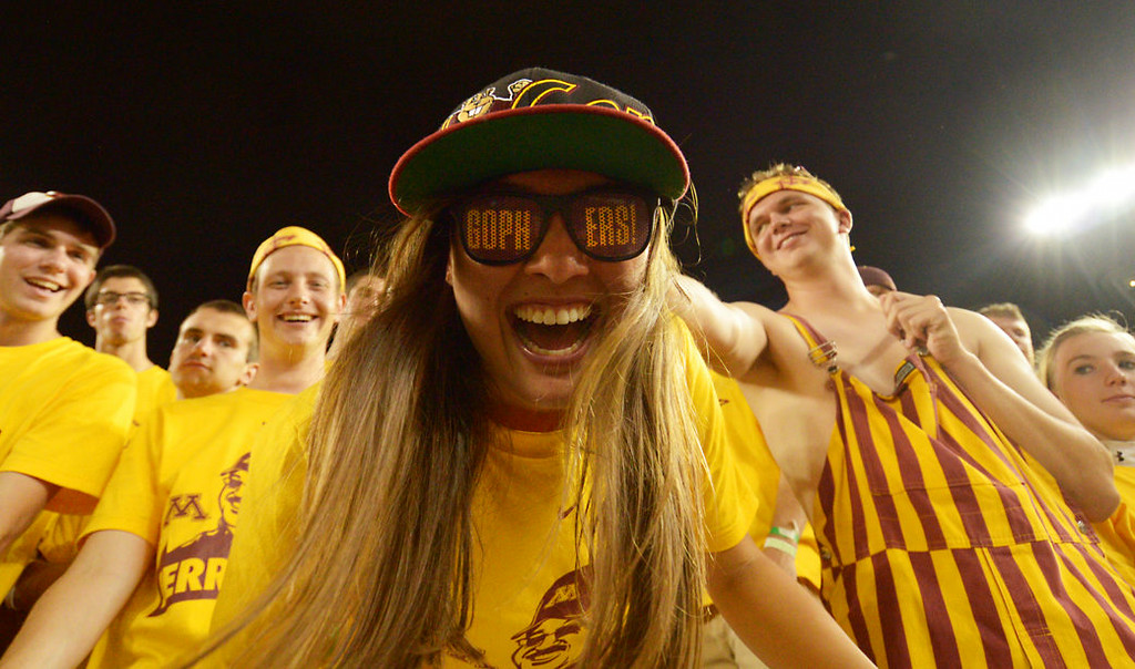 . University of Minnesota senior Emily Kreiter cheers on the Gophers as they take on Eastern Illinois in the fourth quarter. (Pioneer Press: John Autey)
