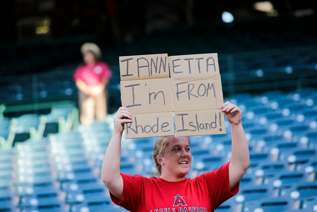 . A fan holds up a sign for Los Angeles Angels\' Chris Iannetta before a baseball game between the Los Angeles Angels and the Houston Astros on Friday, Aug. 16, 2013, in Anaheim, Calif. (AP Photo/Jae C. Hong)