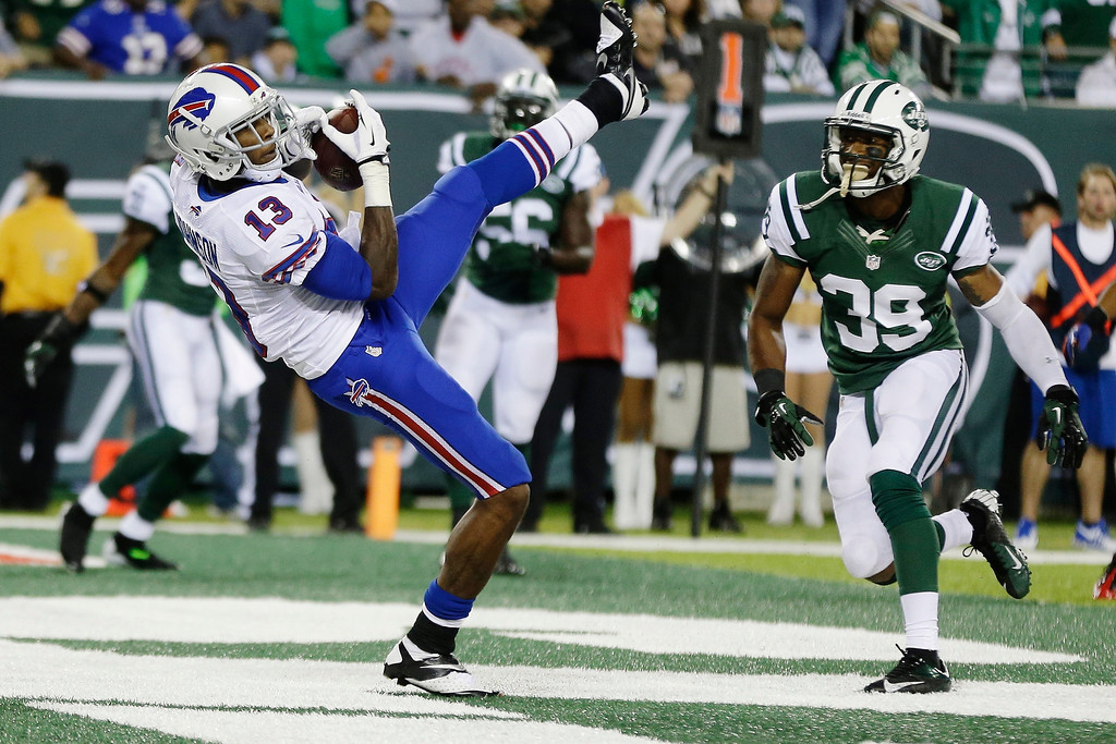 . Buffalo Bills wide receiver Stevie Johnson (13) catches a two-point conversion during the second half of an NFL football game against the New York Jets Sunday, Sept. 22, 2013, in East Rutherford, N.J. (AP Photo/Seth Wenig)