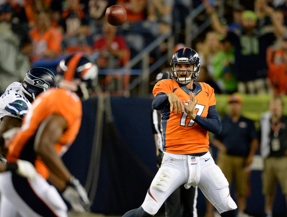 . Denver Broncos quarterback Brock Osweiler (17) throws a pass down field during the third quarter against the Seattle Seahawks August 7, 2014 at Sports Authority Field at Mile High Stadium.  (Photo by John Leyba/The Denver Post)