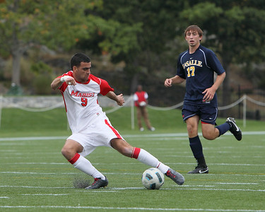 POUGHKEEPSIE, NY - SEPTEMBER 26: Marist Mens Soccer verses La Salle at Marist College on September 26, 2010 in Poughkeepsie New York.  A smooth move by #9 Stephan Brossard on La Salle defender. Photo by Sandy Tambone