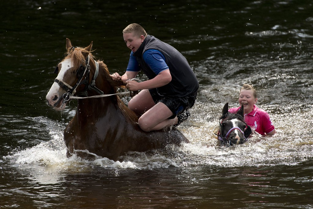. People ride horses into the River Eden to wash them on the opening day of the annual Appleby Horse Fair, in the town of Appleby-in-Westmorland, North West England on June 4, 2015. The annual event attracts thousands of travelers from across Britain to gather and buy and sell horses. AFP PHOTO / OLI SCARFF/AFP/Getty Images