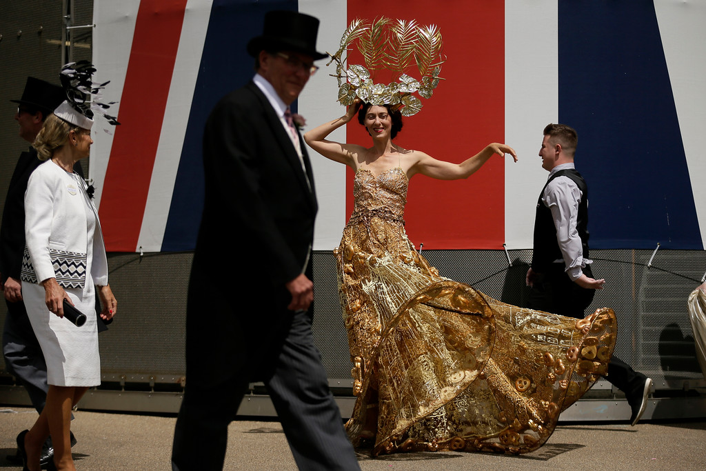 . A racegoer poses for photographers on the second day of the Royal Ascot horse race meeting in Ascot, England, Wednesday, June 20, 2018. (AP Photo/Tim Ireland)
