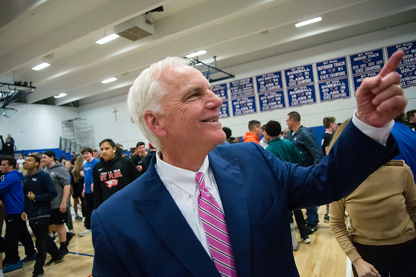 03/09/20 Wesley Bunnell | StaffrrSt. Paul boys basketball vs Maloney at St. Paul Catholic High School on Monday March 9, 2020. St. Paul head coach Steve Phelps looks at the crowd following the victory.