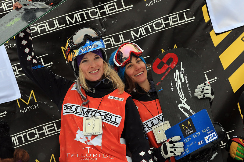 . (L-R)  Dominique Maltais and Maelle Ricker of Canada celebrate on the podium after winning the USANA Snowboardcross World Cup Team Event on December 15, 2012 in Telluride, Colorado.  (Photo by Doug Pensinger/Getty Images)