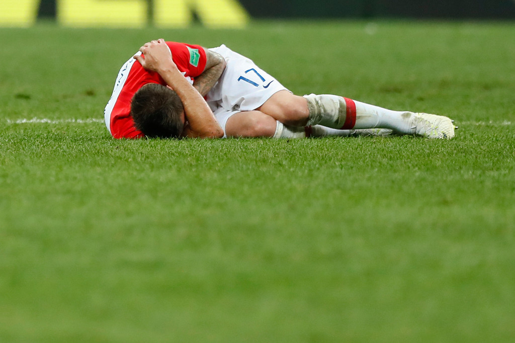 . Croatia\'s Mario Mandzukic lies on the pitch during the final match between France and Croatia at the 2018 soccer World Cup in the Luzhniki Stadium in Moscow, Russia, Sunday, July 15, 2018. (AP Photo/Matthias Schrader)