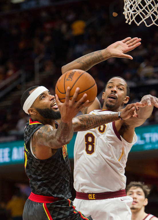 . Atlanta Hawks\' Malcolm Delaney drives past Cleveland Cavaliers\' Channing Frye (8) during the second half of an NBA preseason basketball game in Cleveland, Wednesday, Oct. 4, 2017. The Hawks won 109-93. (AP Photo/Phil Long)