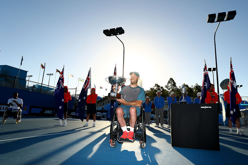 . David Wagner of the United States holds the winners trophy after winning the Quad Wheelchair Singles Final against Lucas Sitole of the United States during the 2014 Australian Open Wheelchair Championships at Melbourne Park on January 25, 2014 in Melbourne, Australia.  (Photo by Robert Prezioso/Getty Images)