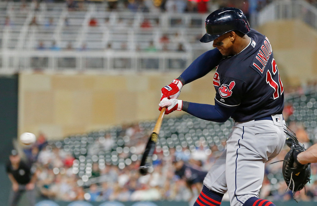 . Cleveland Indians\' Francisco Lindor hits a solo home run off Minnesota Twins pitcher Addison Reed during the eighth inning of a baseball game Thursday, May 31, 2018, in Minneapolis. Lindor went 4-for-5, including a three-run home run in the fourth inning. (AP Photo/Jim Mone)