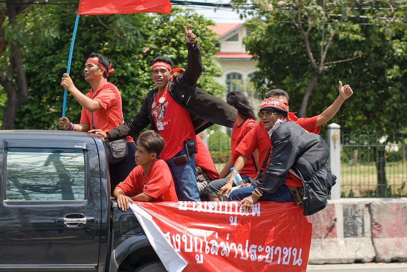 Protesters waving flag from a truck during Red Shirt Protest in Thailand
