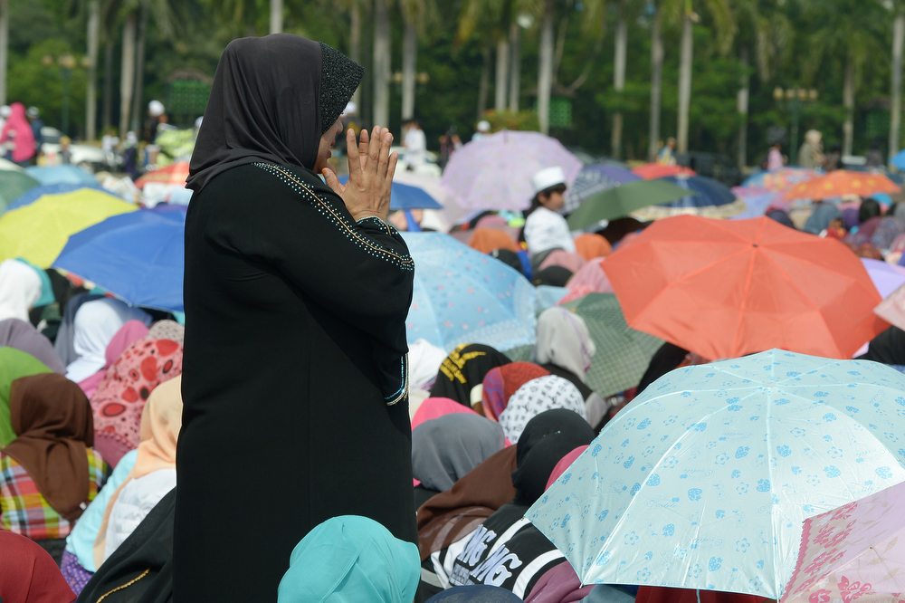 . An Indonesian Muslim woman prays during a mass prayer to celebrate Muhammad\'s birthday in Jakarta on January 14, 2014. Thousands of Muslims in Indonesia celebrated the birthday of prophet Muhammad called Mawlid or locally maulud, which occurs in the third month in the Islamic calendar. (ADEK BERRY/AFP/Getty Images)