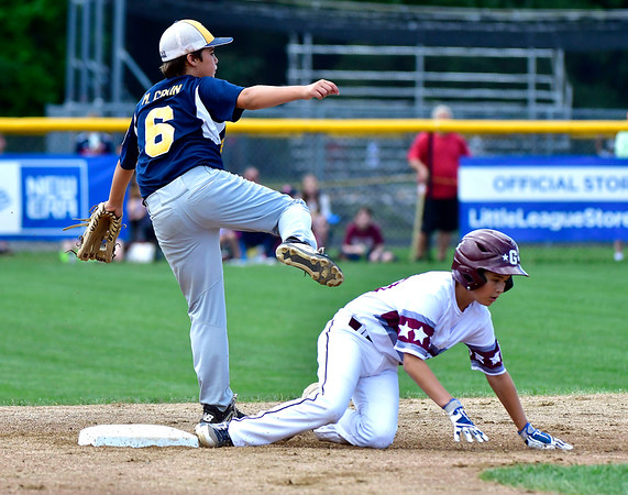 8/10/2019 Mike Orazzi | Staff Rhode Islands Barrington Little League's Mason Crain (6) forces out New Hampshires Goffstown Junior Baseball Little League's Nate Kiah (00) at Breen Field in Bristol, Conn., during the New England Regional Baseball Tournament.