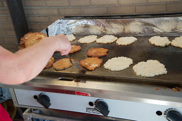 06/28/19 Wesley Bunnell | Staff The Sacred Heart Partish Festival, Odpus, opened Friday June 28, 2019 and will continue thru Saturday. Potato pancakes cook on a grill top.