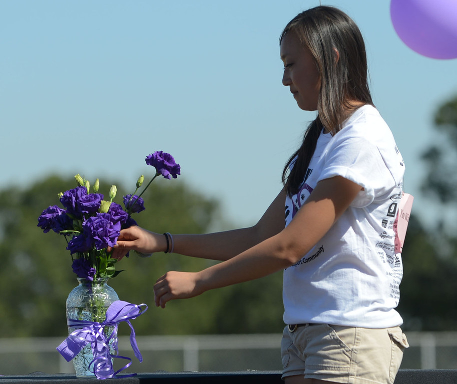 . Hundreds of Peninsula High School students took part in the school\'s Walk for Life on Wednesday which raises money for cancer research and awareness.  Students place flowers that represent a person that is connected to the school who has battled cancer. 20130227 Photo by Steve McCrank / Staff Photographer