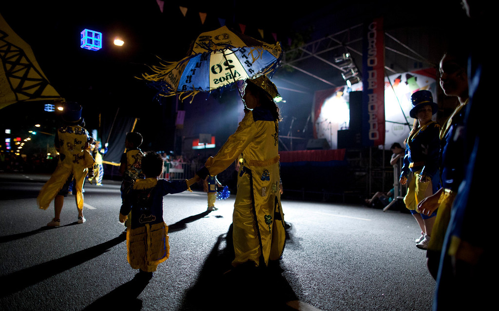 ". Members of the murga \""Los amantes de La Boca\"" perform during carnival celebrations in Buenos Aires, Argentina, Saturday, Feb. 2, 2013.  (AP Photo/Natacha Pisarenko)"