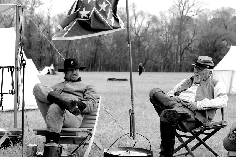 Two members of the 20th North Carolina Infantry, Company A relax in their camp. The Skirmish at Gamble's Hotel happened on March 5, 1885 when 500 federal soldiers, under the command of Reuben Williams of the 12th Indiana Infantry, marched into Florence to destroy the railroad depot but were met by Confederate soldiers backed up with 400 militia. The reenactment, held by the 23rd South Carolina Infantry, was held at the Rankin Plantation in Florence, South Carolina on Saturday, March 5, 2011. Photo Copyright 2011 Jason Barnette