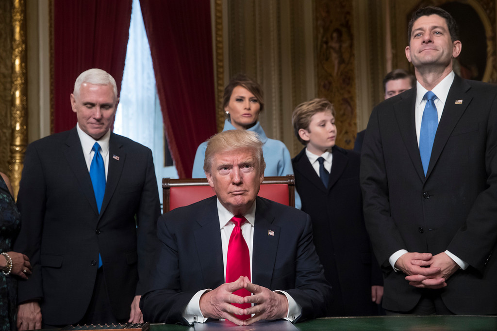. President Donald Trump is joined by the Congressional leadership and his family before formally signing his cabinet nominations into law, Friday, Jan. 20, 2017, in the President\'s Room of the Senate on Capitol Hill in Washington. From left are, Vice President Mike Pence, the president\'s wife Melania Trump, their son Barron Trump, and House Speaker Paul Ryan of Wis. (AP Photo/J. Scott Applewhite, Pool)