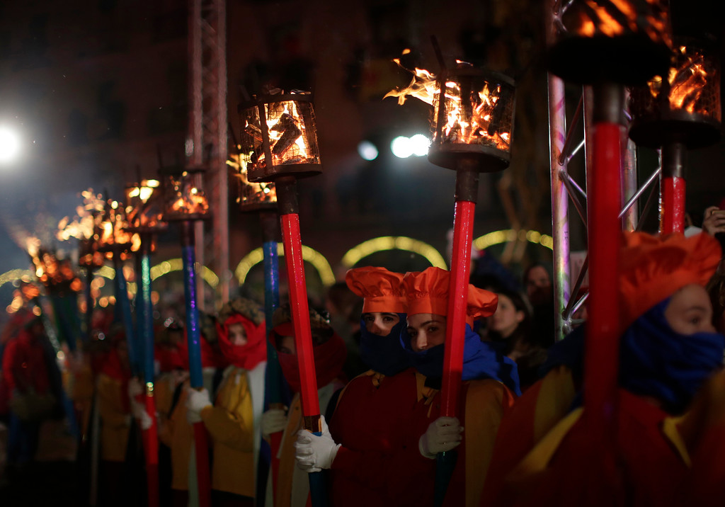 . Performers hold torches during the \'Cabalgata de Reyes,\' or the Three Wise Men parade in Vic, Spain, Thursday, Jan. 5, 2017. The traditional parade marks the eve of the Epiphany, a Christian holiday celebrating the story of the three wise men believed to have followed a bright star to offer gifts of gold, frankincense and myrrh to the newborn Jesus in Bethlehem. (AP Photo/Manu Fernandez)
