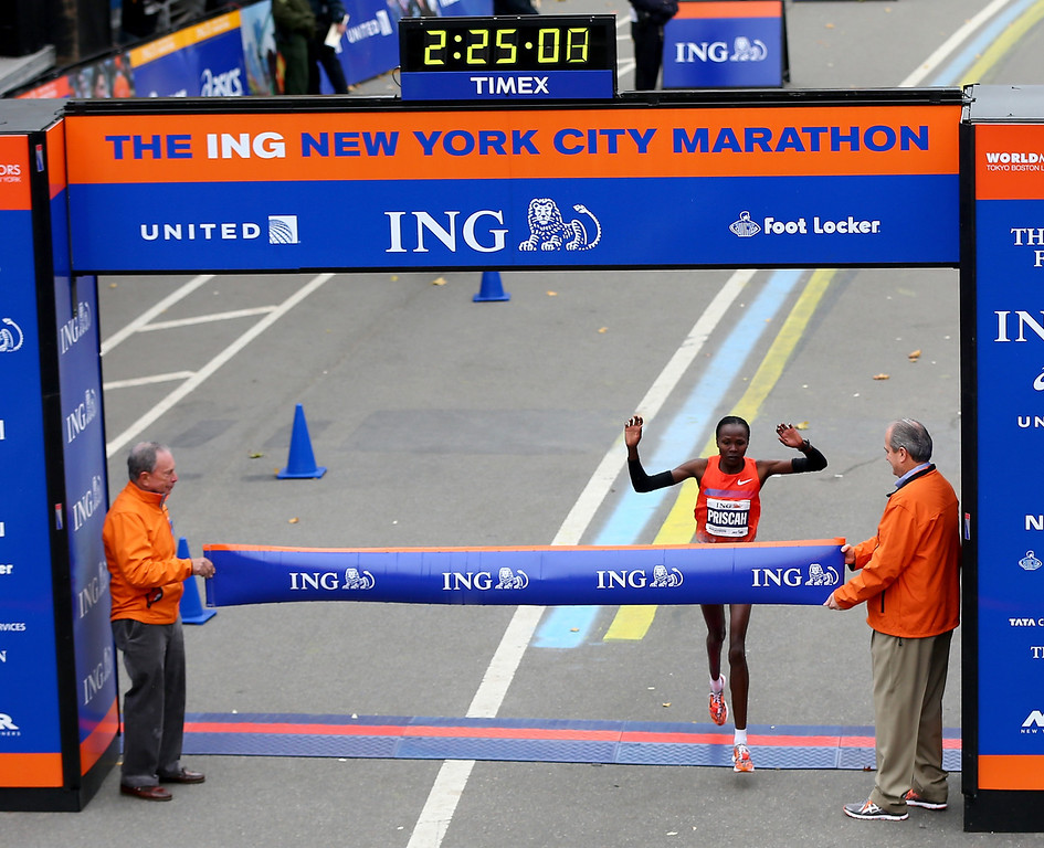 . Priscah Jeptoo of Kenya crosses the finish line in Central Park to win the 2013 ING New York City Marathon on November 3, 2013 in New York City.  (Photo by Elsa/Getty Images)
