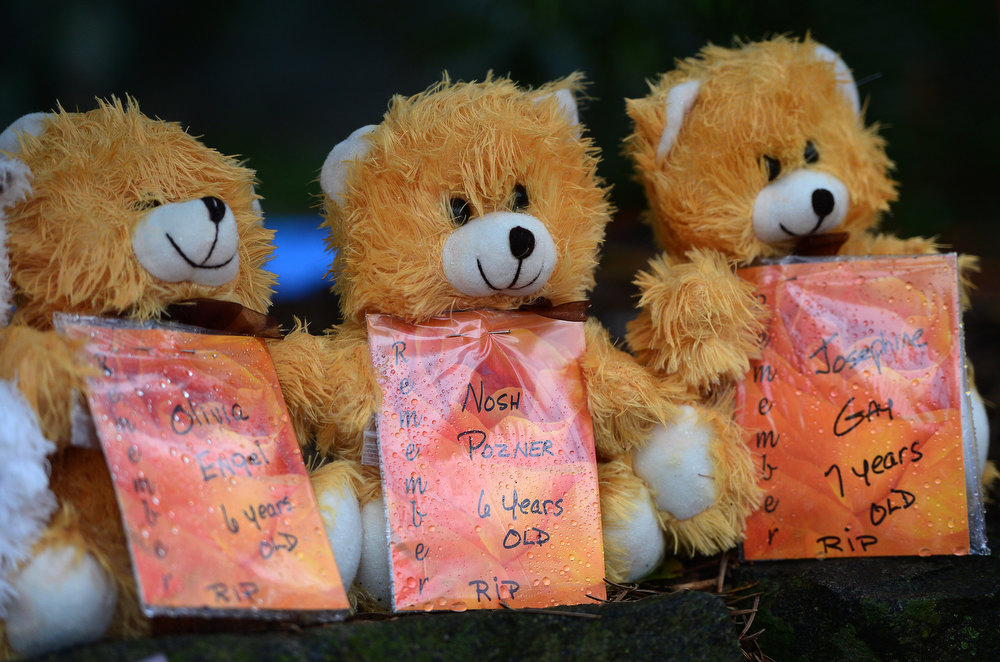 . Teddy bears with the names of some of the victims of the December 14, 2012 elementary school shooting, including Six-year-old Noah Pozner, at a makeshift shrine to the victims in Newtown, Connecticut, December  on 17, 2012. Funerals began Monday in the little Connecticut town of Newtown after the school massacre that took the lives of 20 small children and six staff, triggering new momentum for a change to America\'s gun culture. The first burials, held under raw, wet skies, were for two six-year-old boys who were among those shot in Sandy Hook Elementary School. On Tuesday, the first of the girls, also aged six, was due to be laid to rest. There were no Monday classes at all across Newtown, and the blood-soaked elementary school was to remain a closed crime scene indefinitely, authorities said. AFP PHOTO/Emmanuel DUNAND/AFP/Getty Images