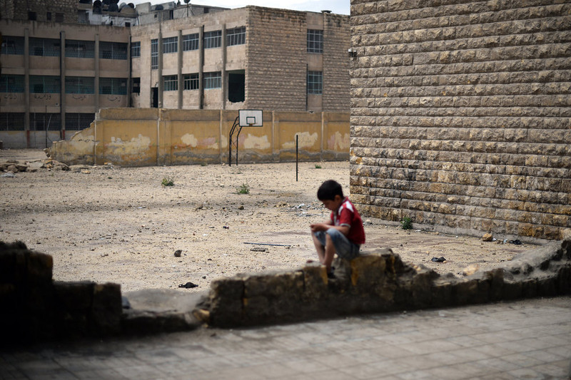 . A Young Syrian boy sits next to a heavily damaged school in the northern Syrian city of Aleppo on April 17, 2013. Russian Foreign Minister Sergei Lavrov criticized the Friends of Syria grouping of Western and Arab countries opposed to the rule of President Bashar al-Assad as negative for dialogue.  DIMITAR DILKOFF/AFP/Getty Images