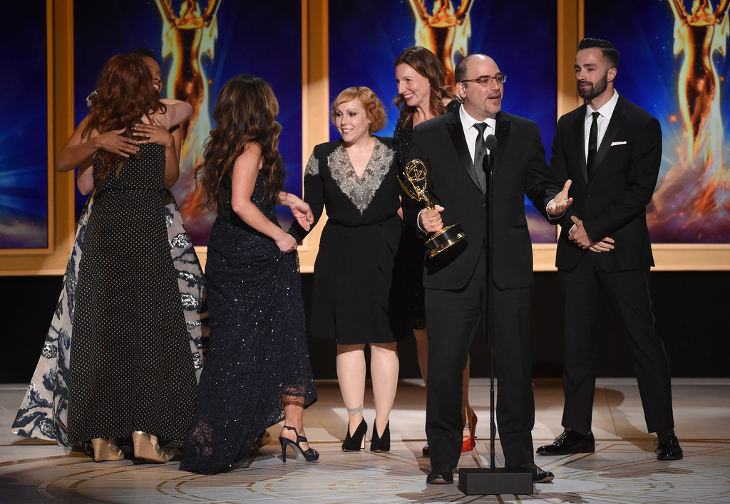 ". The team from ""Saturday Night Live - Host: Tina Fey\"" accepts the award for outstanding makeup for a multi-camera series or special (non-prosthetic) during night two of the Television Academy\'s 2018 Creative Arts Emmy Awards at the Microsoft Theater on Sunday, Sept. 9, 2018, in Los Angeles. (Photo by Phil McCarten/Invision/AP)"