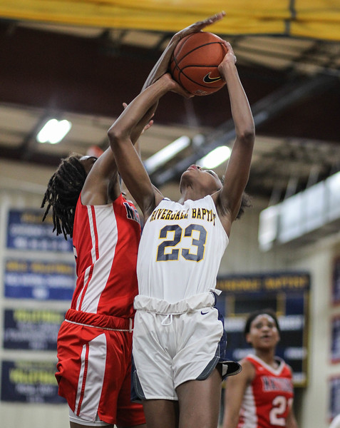 "January 31, 2019: National Christian forward Anissa Rivera (5) blocks Riverdale Baptist guard Jalyn Brown (23) during HS girls basketball action between National Christian Academy and Riverdale Baptist in Upper Marlboro. Photo by: Chris Thompkins/Prince George""s Sentinel"