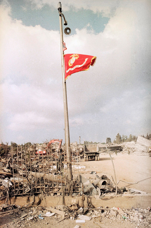 . In this Sunday, Oct. 23, 1983 file photo, the U.S. Marine Corps flag flies at half-staff after a truck bomb destroyed the Marine barracks in Beirut. (AP Photo, File)