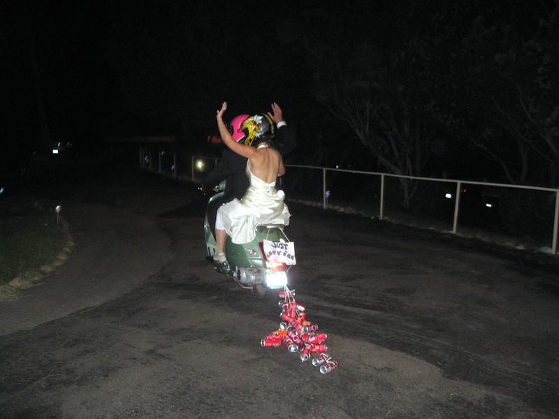 Newlyweds Avram and Abby drive off into the California night on Avram's Vespa