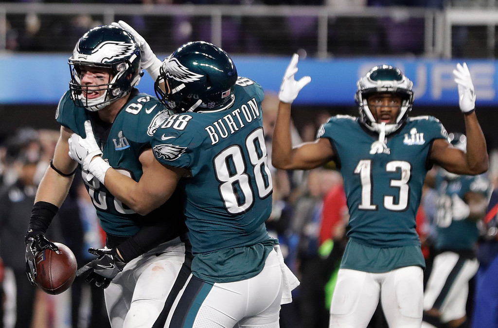 . Philadelphia Eagles\' Zach Ertz, left, celebrates his touchdown catch during the second half of the NFL Super Bowl 52 football game against the New England Patriots Sunday, Feb. 4, 2018, in Minneapolis. (AP Photo/Mark Humphrey)
