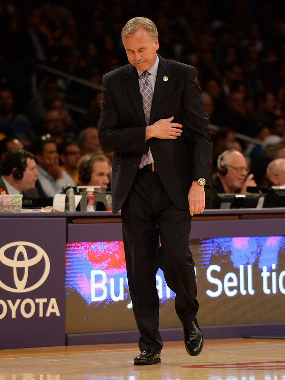 . Los Angeles Lakers head coach Mike D\'Antoni after calling a time-out in the second half during an NBA basketball game against the Dallas Mavericks in Los Angeles, Calif., on Friday, April 4, 2014. Dallas Mavericks won 107-95.  (Keith Birmingham Pasadena Star-News)