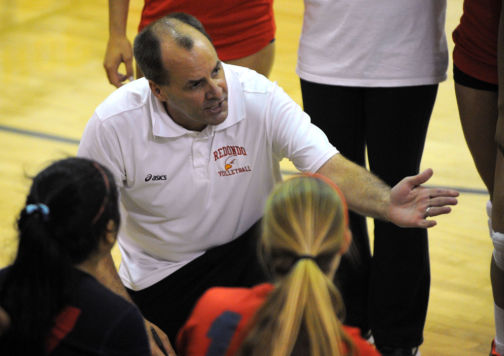 . Redondo girls volleyball takes on Bishop Montgomery in a non league match in Torrance on 09/10/2013. Redondo won 3-0. Redondo coach Tommy Chaffins works with his players during a timeout. (Photo by Scott Varley, Daily Breeze)
