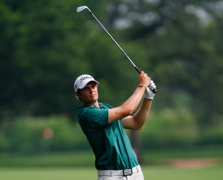 Peter Uihlein of Orlando, Fla., hits his tee shot on the 14th hole, during the first round Tuesday.