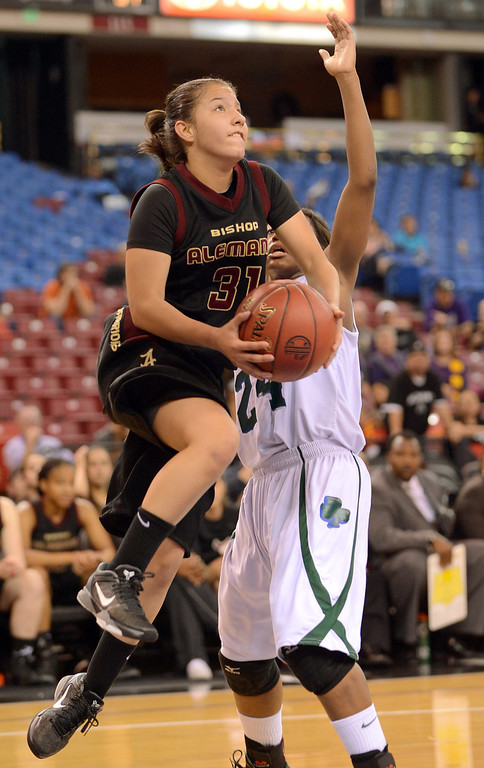 . Alemany\'s Genessa Bedoya gets by Briannah Smith of Sacred Heart Cathedral during the Div III 2013 CIF State Basketball Championship game at the Sleep Train Arena, in Sacramento, Ca March 22, 2013.  Alemany won the game 46-40.(Andy Holzman/Los Angeles Daily News)
