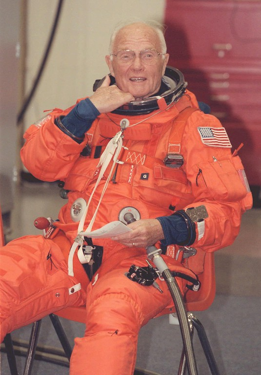 . Senator John Glenn, D-Ohio, plugs in to a flight suit air conditioning unit before a training simulation on a space shuttle mockup at Johnson Space Center in Houston Thursday, June 25, 1998. Glenn is scheduled to fly into orbit aboard the shuttle in October. (AP Photo/Michael Stravato)