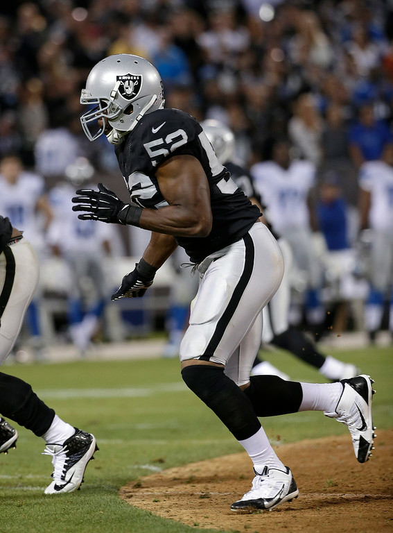 . Oakland Raiders outside linebacker Khalil Mack (52) against the Detroit Lions during the second quarter of an NFL preseason football game in Oakland, Calif., Friday, Aug. 15, 2014. (AP Photo/Marcio Jose Sanchez)