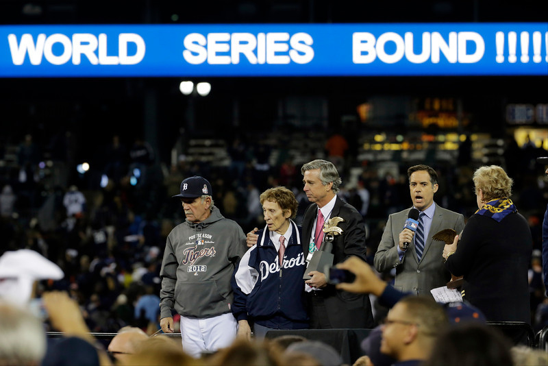 . Detroit Tigers manager Jim Leyland, left, joins Tigers owner Mike Ilitch, second from left and general manager Dave Dombrowski, center to receive the William Harridge Trophy after the team won the American League championship series against the New York Yankees in Game 4, Thursday, Oct. 18, 2012, in Detroit. The Tigers, who won 8-1, move on to the World Series.  (AP Photo/Charlie Riedel)