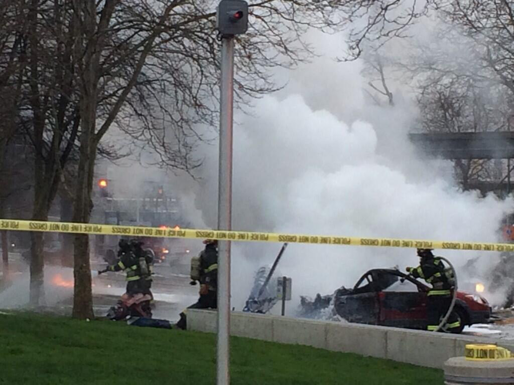 . In this photo provided by KOMO-TV, emergency personnel respond to the scene of a helicopter crash outside the KOMO-TV studios near the space needle in Seattle on Tuesday, March 18, 2014.  (AP Photo/KOMO-TV, Kelly Koopmans)