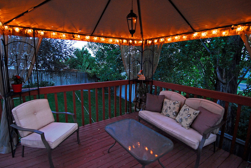 2011/6/25 – This is what Lisa and I spent a good portion of our Saturday doing – setting up this gazebo on our deck and stringing all the lights around the edge. it took longer than expected because it just barely fit on the deck. We were beat when we finished because it was such a hot day, but we will love spending our summer evenings enjoying the evening breeze. The idea came from my good friend Rick who has two gazebos on his back deck that can be seen here: http://tinyurl.com/5rmh8lt