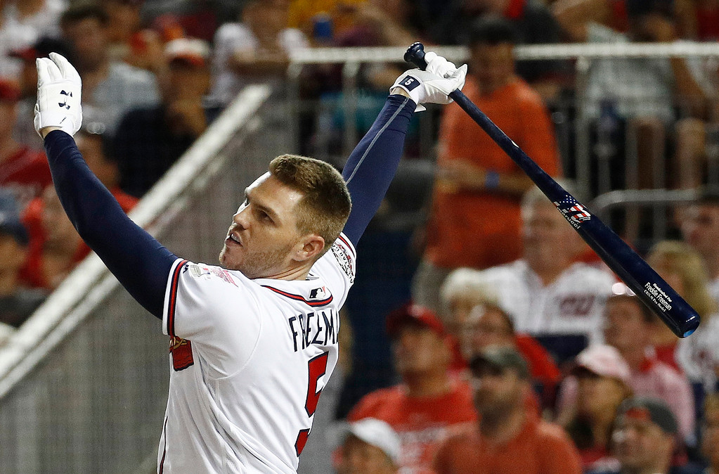 . Atlanta Braves Freddie Freeman (5) watches his hit during the MLB Home Run Derby, at Nationals Park, Monday, July 16, 2018 in Washington. The 89th MLB baseball All-Star Game will be played Tuesday. (AP Photo/Patrick Semansky)
